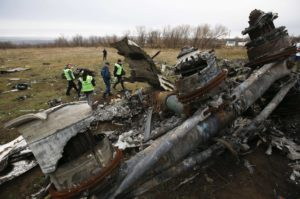 Dutch investigators and an Emergencies Ministry member work at the site where the downed Malaysia Airlines flight MH17 crashed, near the village of Hrabove (Grabovo) in Donetsk region, eastern Ukraine November 16, 2014. Local emergency services have begun collecting parts of the wreckage from its crash site in the middle of the conflict zone, Dutch air accident investigators said on Sunday. Dutch inspectors had hoped to collect the parts themselves, following the downing of the flight on July 17 that killed 298 people, two thirds of them Dutch citizens. But they remain concerned about the safety of their staff in the rebel-held conflict zone, and so have decided to work with local services following an initial focus on finding human remains and belongings. REUTERS/Maxim Zmeyev (UKRAINE - Tags: DISASTER POLITICS TRANSPORT TPX IMAGES OF THE DAY)